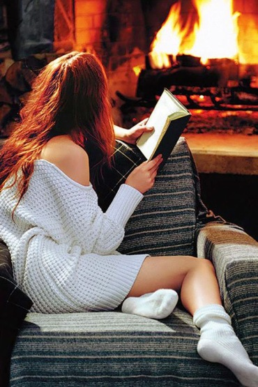 reading_by_the_fireplace